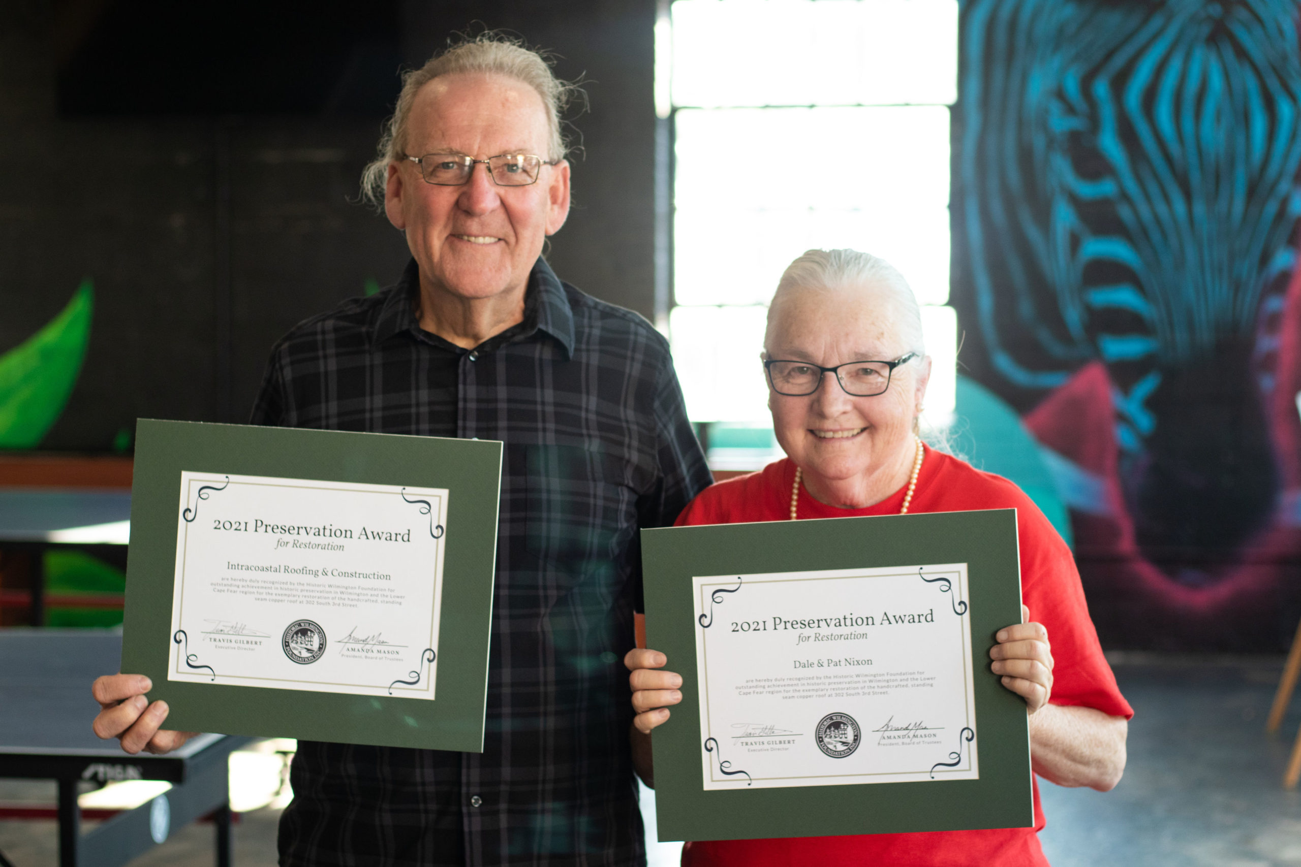 Dale & Pat Nixon and Intracoastal Roofing & Construction won a Preservation Award for their restoration of the Barry House's metal roof, which failed during Hurricane Florence.